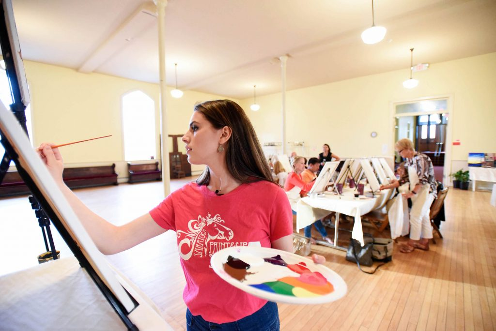 Community members participate in a Paint and Sip event at Universal Preservation Hall in Saratoga Thursday, July 6, 2017. The event was the last that will take place at UPH before they close their doors for renovation.