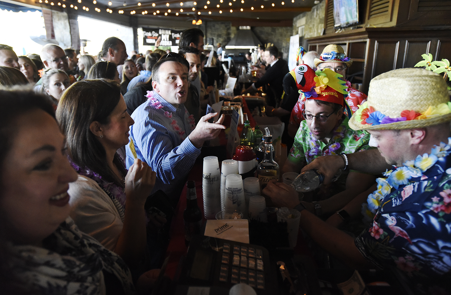 Supporters fill the bar and patio at Prime at Saratoga National Golf Course for Shaken & Stirred, a fundraised for UPH May 16, 2019.