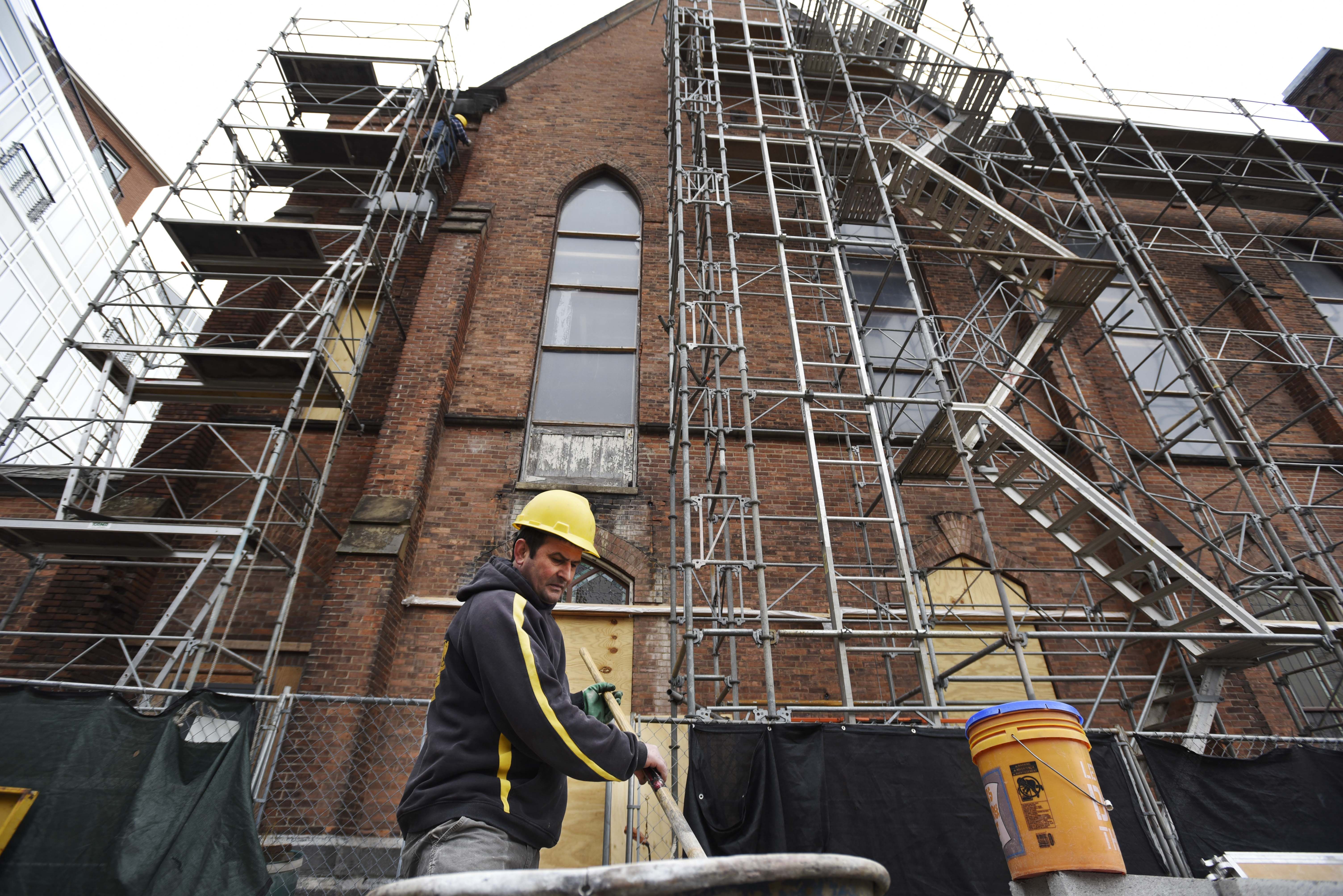 A construction workers mixes lime to use in brick restoration work on the exterior of Universal Preservation Hall in Saratoga Tuesday, April 9, 2019.