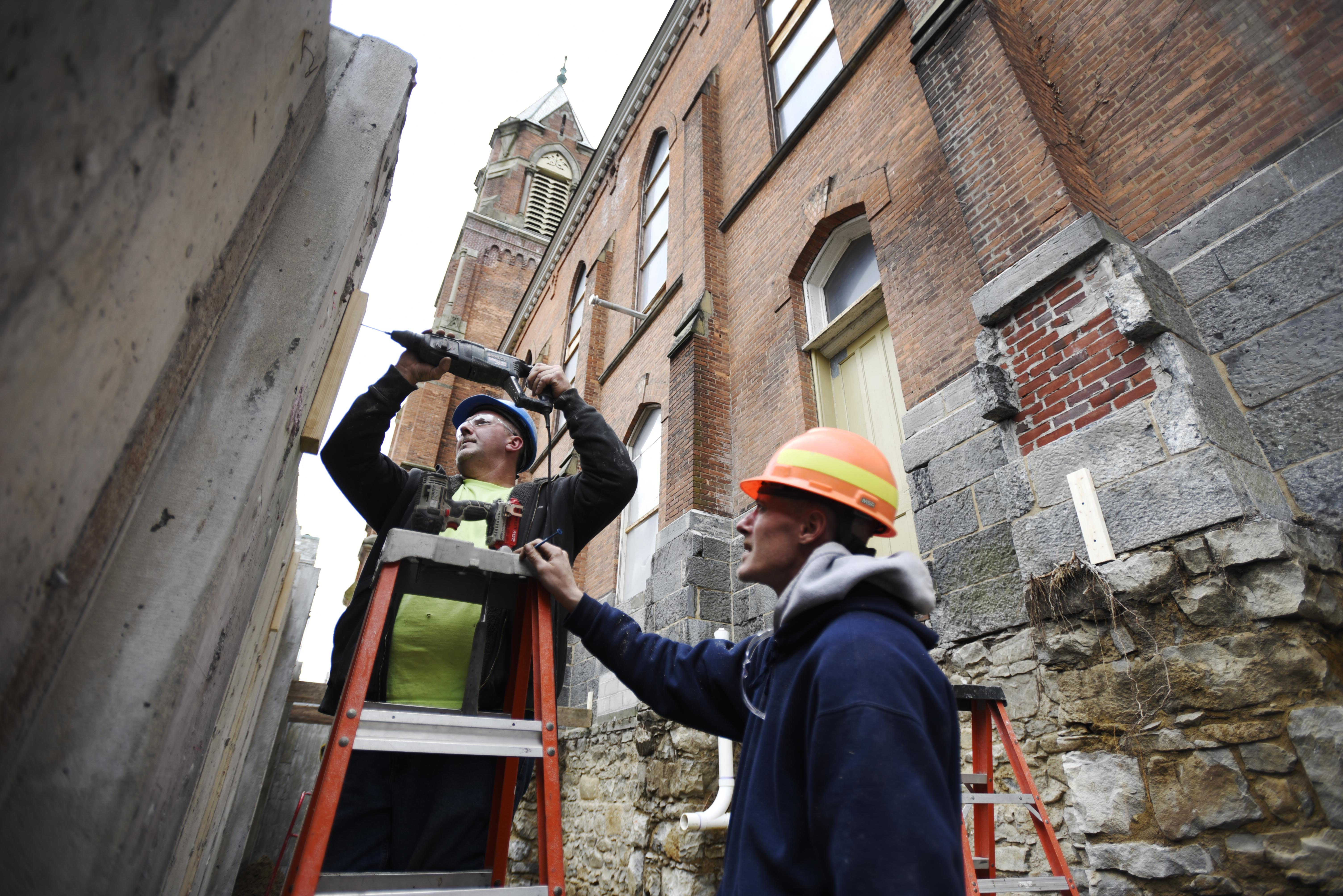 Construction workers work on the exterior at Universal Preservation Hall in Saratoga Tuesday, April 9, 2019.