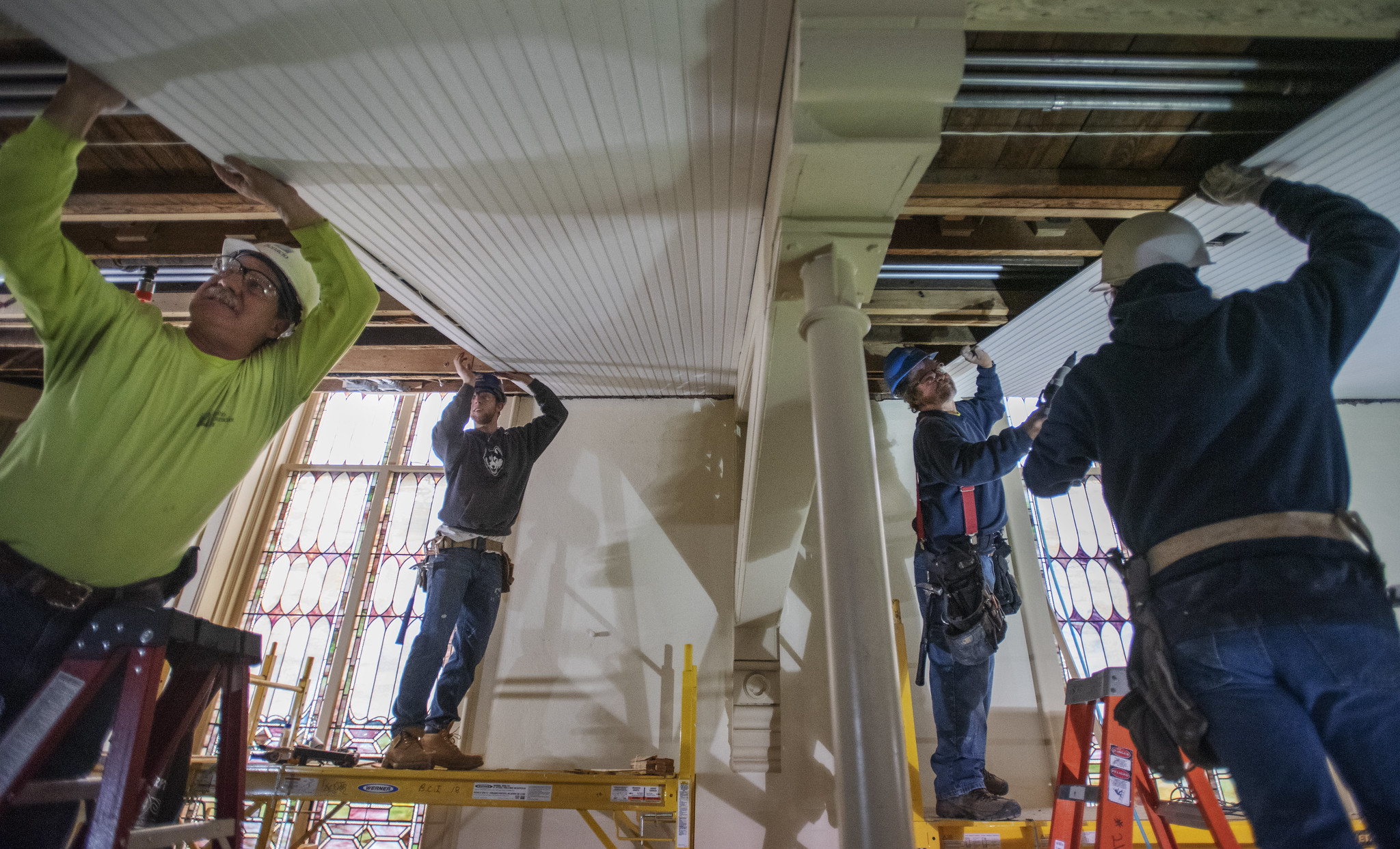 Construction workers attach wainscotting under the balcony during construction at UPH Monday, Novermber 11, 2019. A construction worker said it would take 300 miles of wainscotting to complete the project. Photo credit: Kate Penn - Proctors