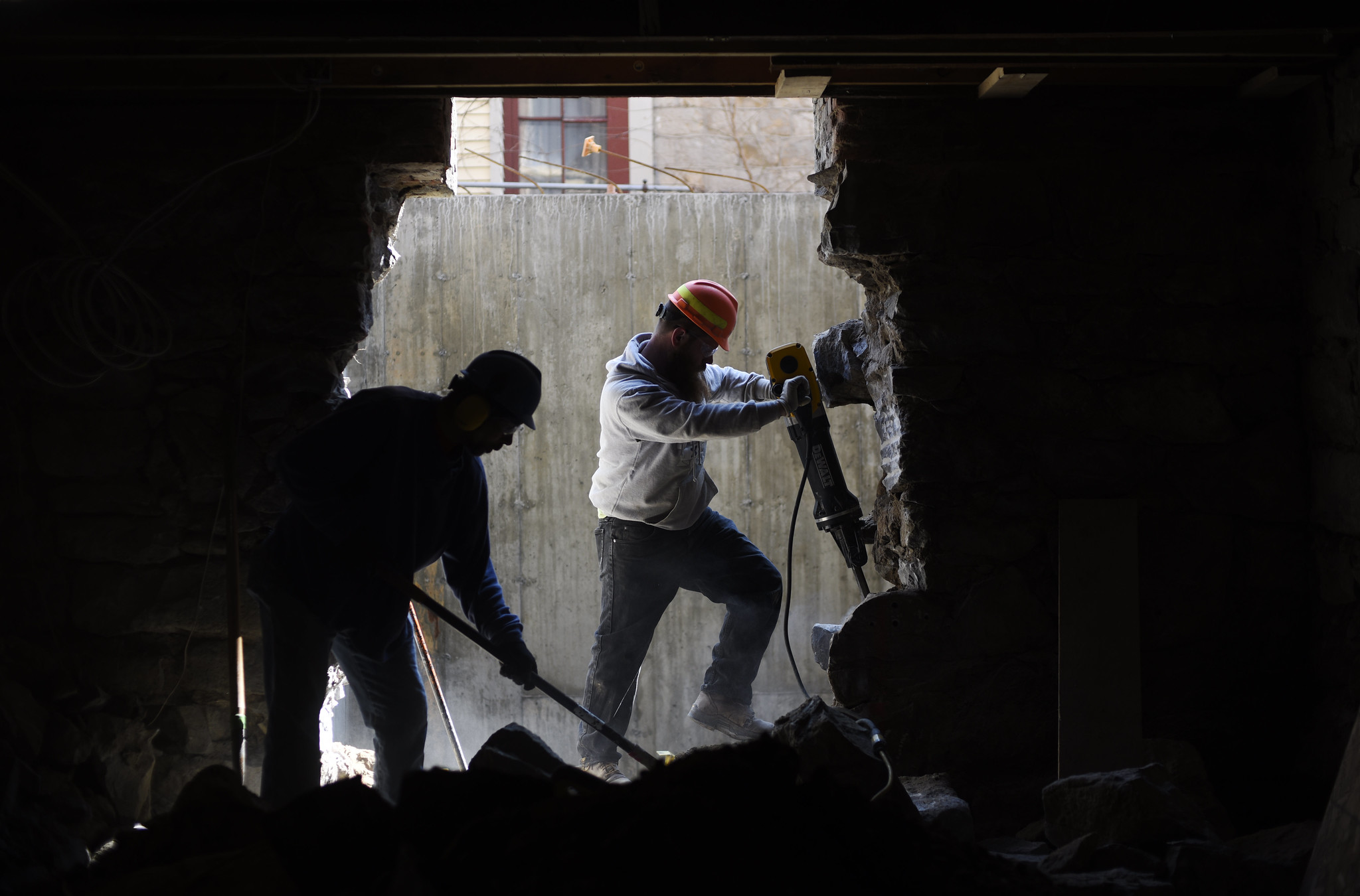 Construction workers use a jackhammer and shovel to break up and clear stone on the basement at Universal Preservation Hall in Saratoga Tuesday, April 9, 2019.