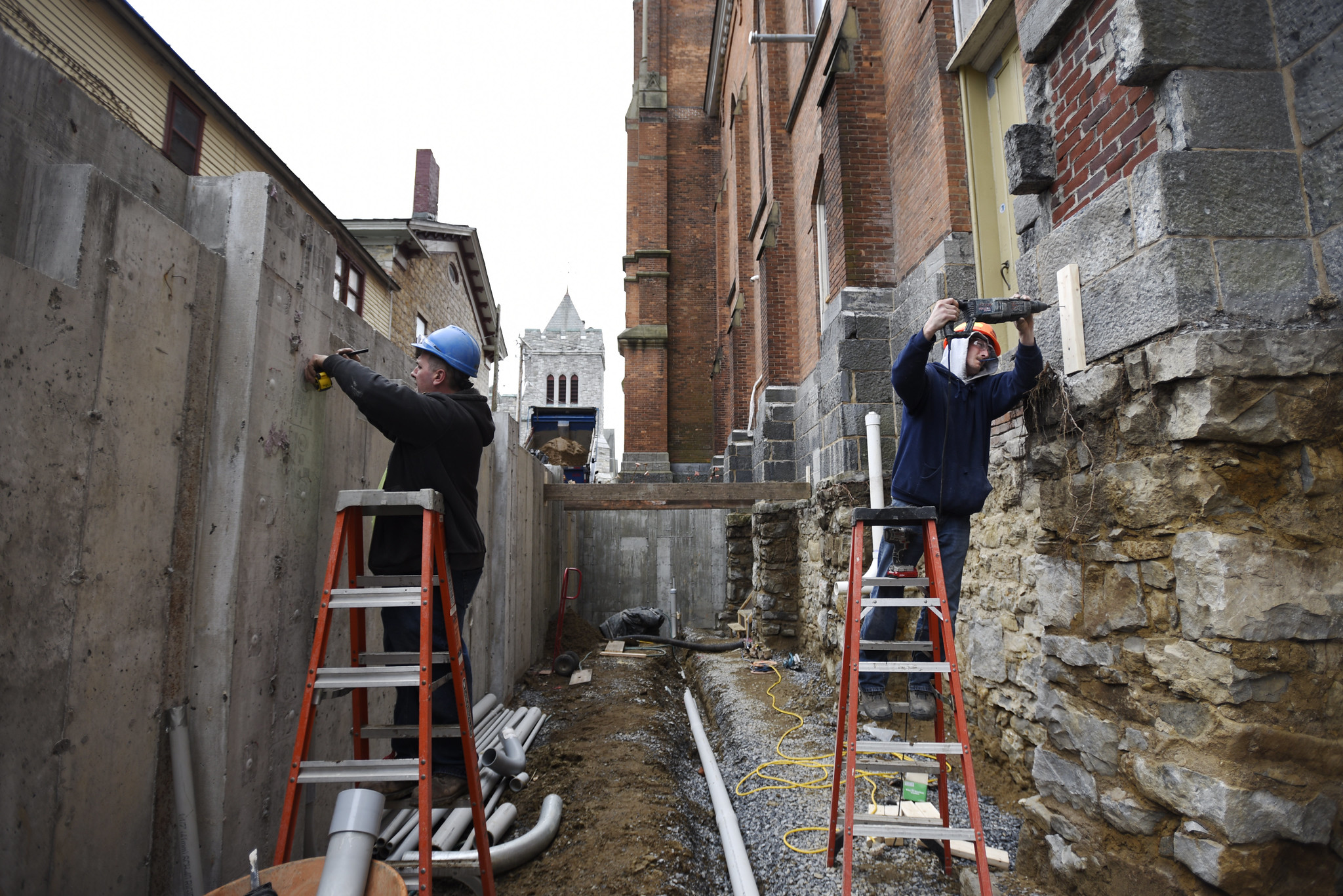 Construction crews work on the exterior where the glass atrium will be built at Universal Preservation Hall in Saratoga Tuesday, April 9, 2019.
